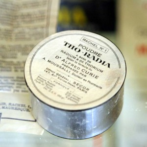 Tho-radia powder box, based on radium ad thorium, according to the formula by Dr Alfred Curie, on display at the Musée Curie, Paris. Wikipedia.